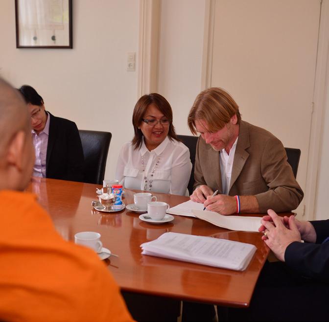 De ondertekening van het koopcontract.