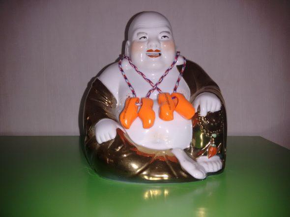 Kuudmurning lachende dikke boeddha liggend
