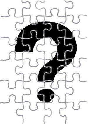 Witte legpuzzel met een zwart vraagteken.